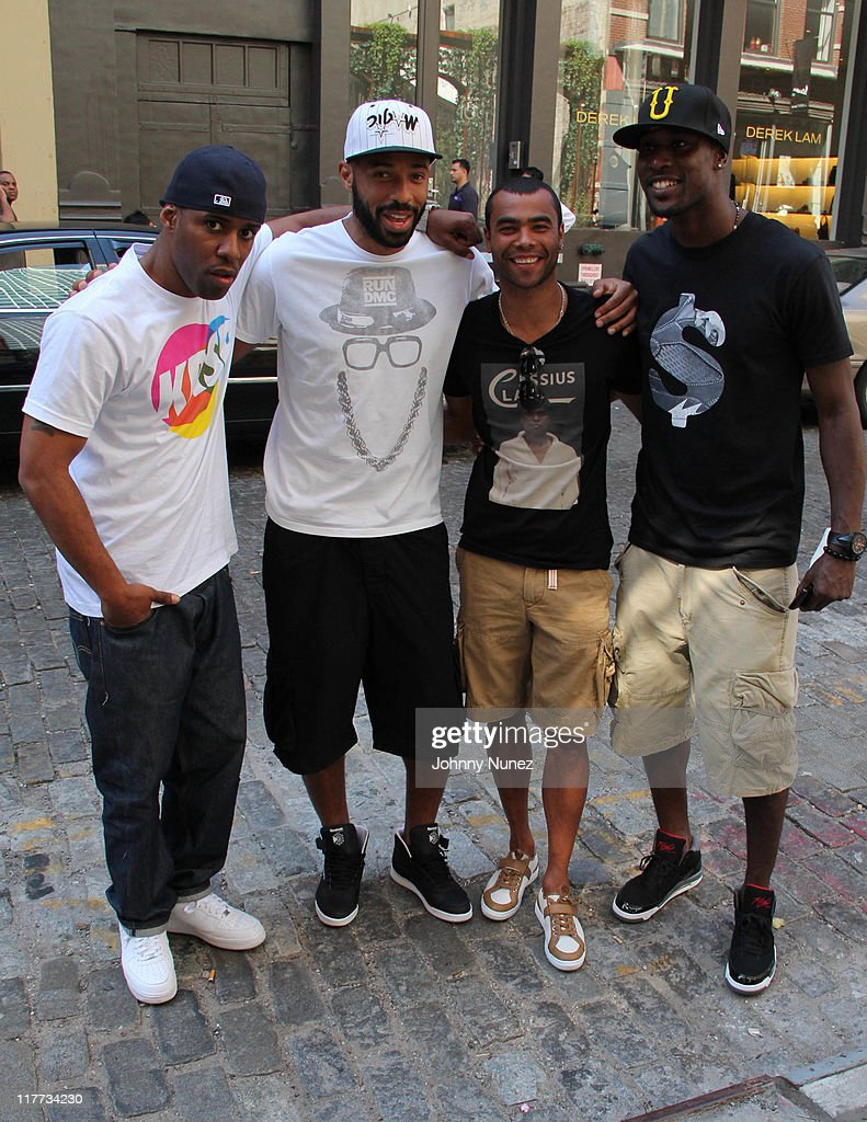 DJ Whoo Kid, New York Red Bulls <a gi-track='captionPersonalityLinkClicked' href=/galleries/search?phrase=Thierry+Henry&family=editorial&specificpeople=167275 ng-click='$event.stopPropagation()'>Thierry Henry</a>, Chelsea's <a gi-track='captionPersonalityLinkClicked' href=/galleries/search?phrase=Ashley+Cole&family=editorial&specificpeople=201831 ng-click='$event.stopPropagation()'>Ashley Cole</a> and West Ham United's <a gi-track='captionPersonalityLinkClicked' href=/galleries/search?phrase=Carlton+Cole&family=editorial&specificpeople=215313 ng-click='$event.stopPropagation()'>Carlton Cole</a> seen on the streets of Manhattan on June 30, 2011 in New York City.