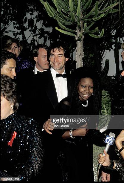 Whoopi Goldberg and Timothy Dalton during Swifty Lazar's Oscar Party March 30 1992 at Spago's in Los Angeles California United States