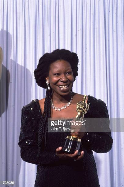 Whoopi Goldberg receives an Oscar at the 63Th Academy Awards on March 25 1991 in Los Angeles CA