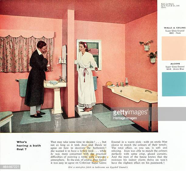 'Who's having a bath first' 1950s A husband and wife in their newly decorated bathroom An advertisement for the paint company Robbialac