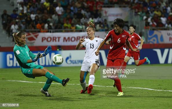 Wi Jong Sim of Korea DPR scores a goal during the FIFA U20 Women's World Cup Final match between Korea DPRand France at the National Football Stadium...