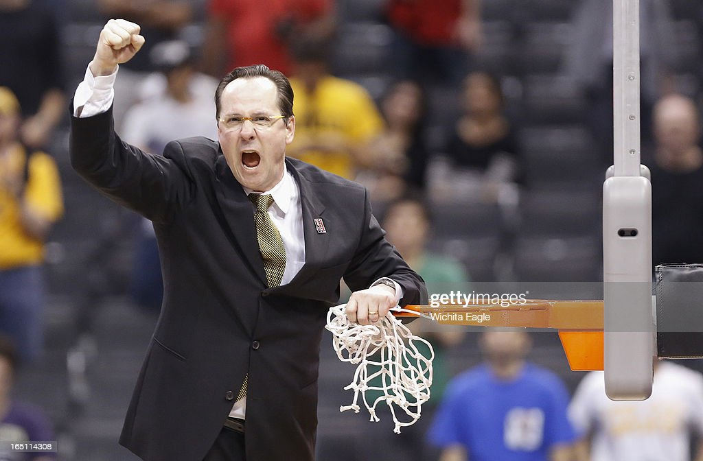 Wichita State coach Gregg Marshall encourages the crowd after cutting down the net following a 70-66 win against Ohio State in the West Region Final of the NCAA Tournament on Saturday, March 29, 2013, at Staples Center in Los Angeles, California.