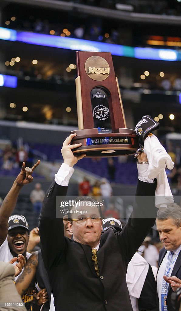 Wichita State coach Gregg Marshall holds up the West Regional Final trophy after beating Ohio State, 70-66, in the West Region Final of the NCAA Tournament on Saturday, March 29, 2013, at Staples Center in Los Angeles, California.