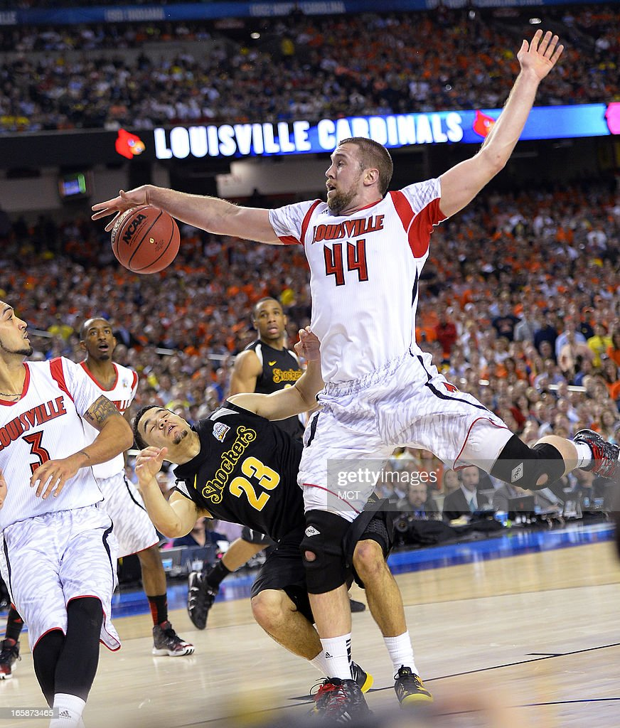 Wichita State guard Fred VanVleet (23) goes to the floor as he is defended by Louisville forward Stephan Van Treese (44) in the second half of a semi-final matchup in the NCAA Men's Basketball Championship at the Georgia Dome in Atlanta, Georgia, Saturday, April 6, 2013.