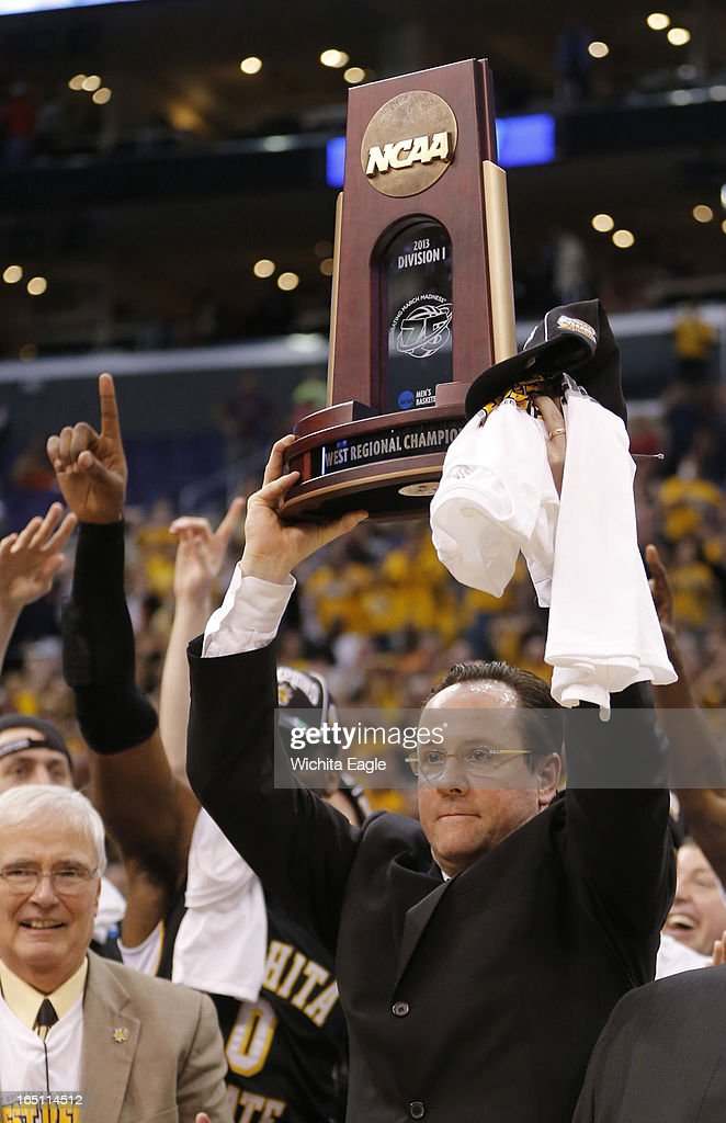 Wichita State head coach Gregg Marshall holds the winner's trophy aloft after defeating Ohio State, 70-66, in the West Region Final of the NCAA Tournament on Saturday, March 29, 2013, at Staples Center in Los Angeles, California.