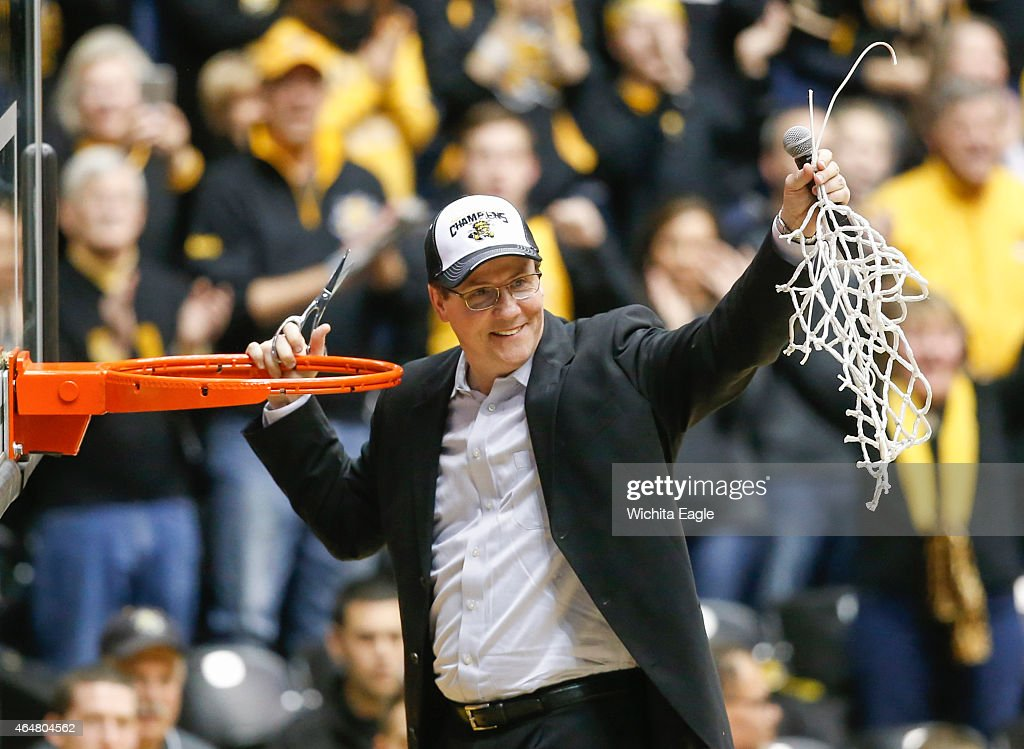 Wichita State head coach <a gi-track='captionPersonalityLinkClicked' href=/galleries/search?phrase=Gregg+Marshall&family=editorial&specificpeople=623591 ng-click='$event.stopPropagation()'>Gregg Marshall</a> holds up the net after his team clinched the Missouri Valley Conference title with a 74-60 win against Northern Iowa at Koch Arena in Wichita, Kan., on Saturday, Feb. 28, 2015.