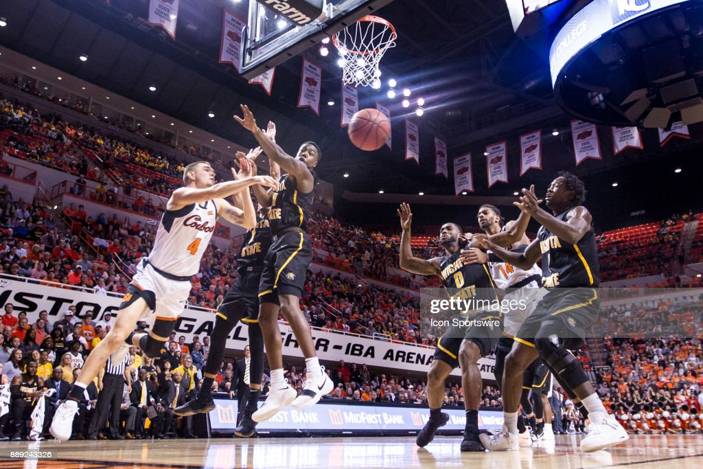 Wichita State Shockers and Oklahoma State Cowboys go after a loose ball during the division one college mens basketball game between the Wichita State Shockers and the Oklahoma State Cowboys on December 9, 2017 at Gallagher-Iba Arena in Stillwater, Oklahoma.