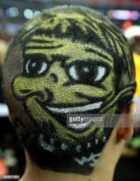 Wichita State Shockers fan has the logo painted on the back of his head before the Shockers take on the Louisville Cardinals in the 2013 NCAA Men's...