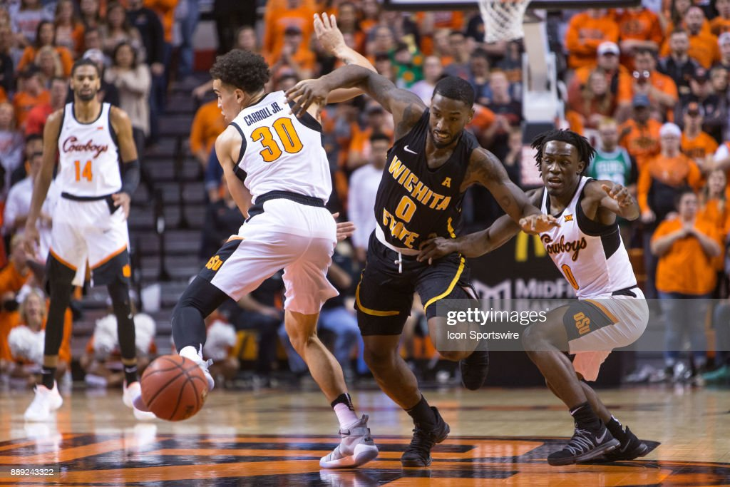 Wichita State Shockers forward Rashard Kelly (0) goes after a loose ball during the college mens basketball game between the Wichita State Shockers and the Oklahoma State Cowboys on December 9, 2017 at Gallagher-Iba Arena in Stillwater, Oklahoma.