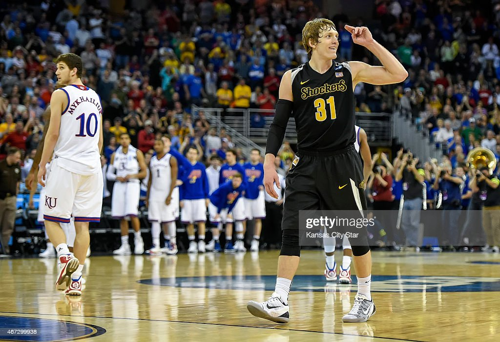 Wichita State Shockers guard <a gi-track='captionPersonalityLinkClicked' href=/galleries/search?phrase=Ron+Baker+-+Basketballspieler&family=editorial&specificpeople=13909614 ng-click='$event.stopPropagation()'>Ron Baker</a> (31) salutes the Wichita State fans at the final buzzer of their 78-65 victory over the Kansas Jayhawks during the third round of the NCAA men's basketball tournament on Sunday, March 22, 2015, at CenturyLink Center in Omaha, Neb.