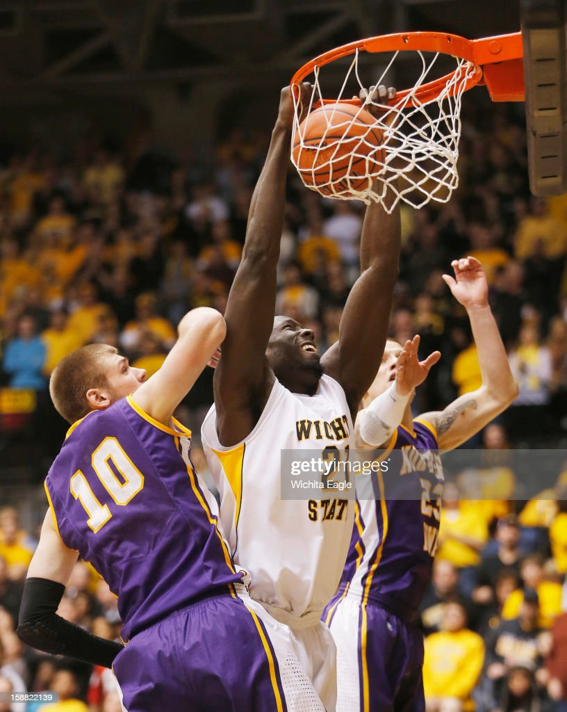 Wichita State University's Ehimen Orukpe dunks the ball in the second period against University of Northern Iowa at Koch Arena in Wichita, Kansas on Sunday, December 30, 2012. WSU won 66-41.