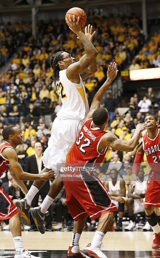 Wichita State's Carl Hall shoots fior two against Bradley's Dyricus Simms-Edwards (32) in the second half at Koch Arena in Wichita, Kansas, Saturday, January 26, 2013. WSU defeated Bradley, 73-39.