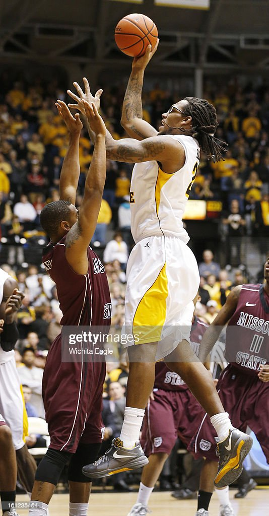 Wichita State's Carl Hall shoots for two against Missouri State's Keith Pickens in the first half at Koch Arena in Wichita, Kansas, on Saturday, February 9, 2013.