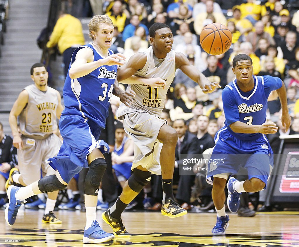 Wichita State's Cleanthony Early (11) fights for a loose ball with Drake's Ben Simons (34) and Richard Carter (3) in the second half at Koch Arena in Wichita, Kansas, on Wednesday, February 13, 2013. Wichita State topped Drake, 71-56.