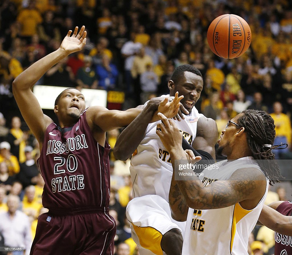 Wichita State's Ehimen Orukpe, middle, and Carl Hall, right, fight for a rebound with Missouri State's Gavin Thurman (20) in the first half at Koch Arena in Wichita, Kansas, on Saturday, February 9, 2013.