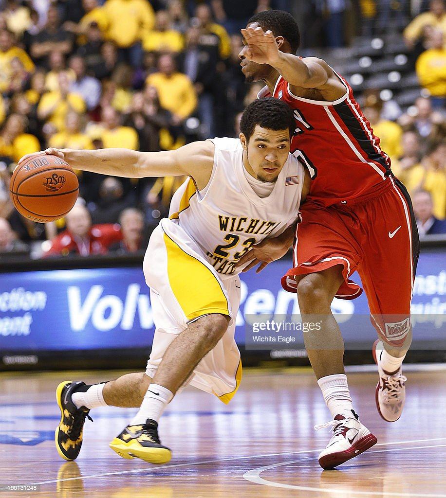 Wichita State's Fred Van Vleet drives on Bradley's Ka'Darryl Bell, right, in the second half at Koch Arena in Wichita, Kansas, Saturday, January 26, 2013. WSU defeated Bradley, 73-39.