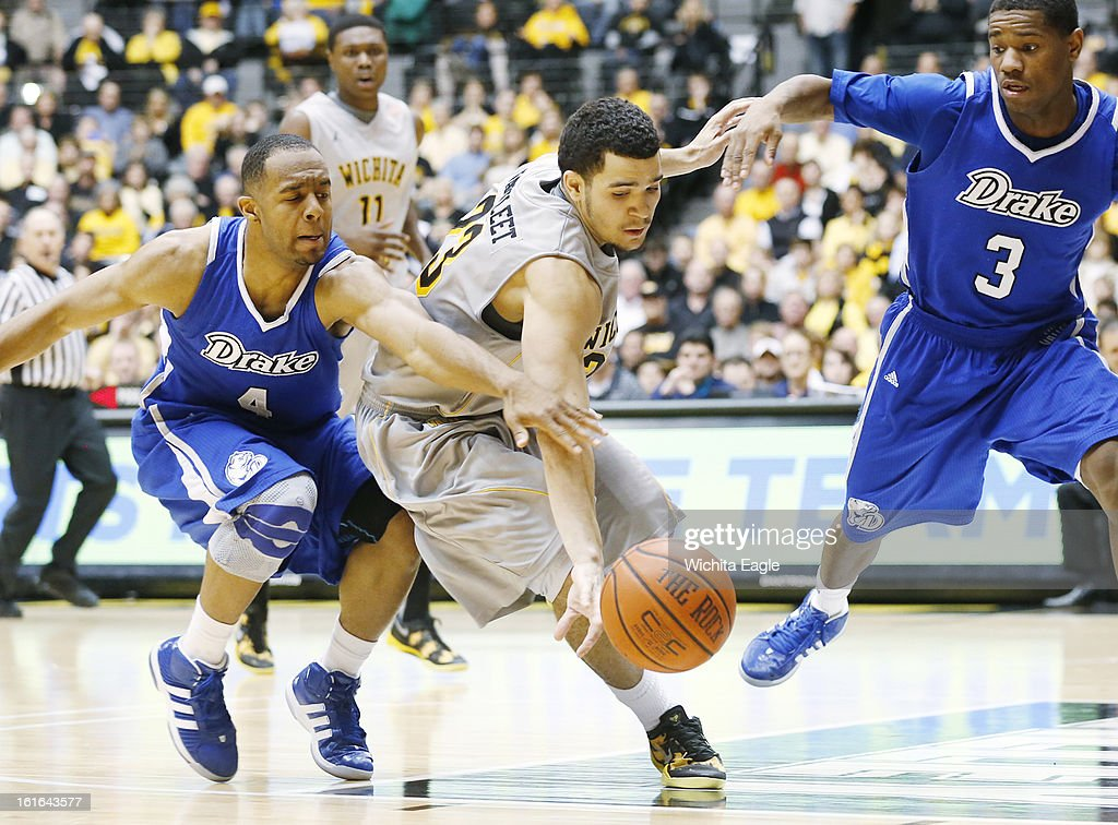 Wichita State's Fred van Vleet fights for a loose ball with Drake's Chris Hines (4) and Richard Carter (3) in the second half at Koch Arena in Wichita, Kansas, on Wednesday, February 13, 2013. Wichita State topped Drake, 71-56.