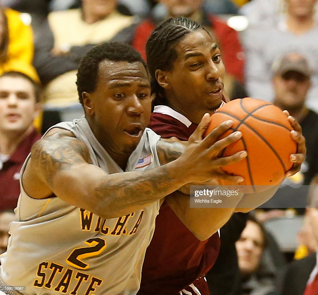 Wichita State's Malcom Armstead, left, and Southern Illinois' Desmar Jackson, right, fight for a loose ball in the second half at Koch Arena in Wichita, Kansas, on Wednesday, January 9, 2013. The host Shockers won, 82-76.