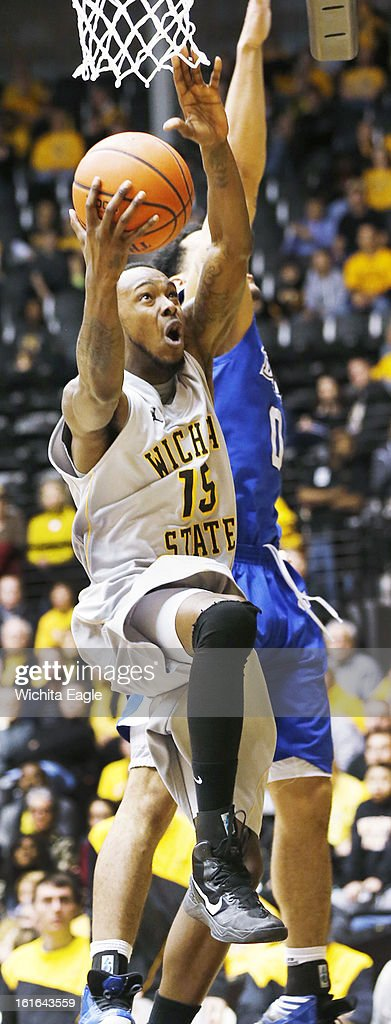 Wichita State's Nick Wiggins (15) drives for a reverse layup against Drake's Kori Babineaux in the second half at Koch Arena in Wichita, Kansas, on Wednesday, February 13, 2013. Wichita State topped Drake, 71-56.