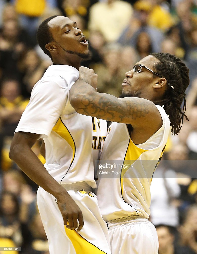 Wichita State's Nick Wiggins, left, gets congratulated by teammate Carl Hall, after Wiggins hit a three-pointer in the second half against Bradley at Koch Arena in Wichita, Kansas, Saturday, January 26, 2013. WSU defeated Bradley, 73-39.