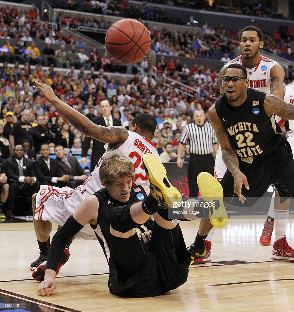 Wichita State's Ron Baker, bottom, and Ohio State's Lenzelle Smith collide in the West Region Final of the NCAA Tournament on Saturday, March 29, 2013, at Staples Center in Los Angeles, California. Wichita State won, 70-66.