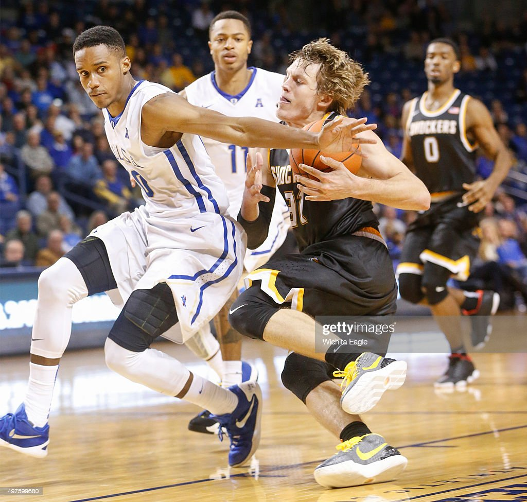 Wichita State's Ron Baker right is fouled and knocked down by Tusla's James Woodard during the second half at the Reynolds Center in Tulsa Okla on...