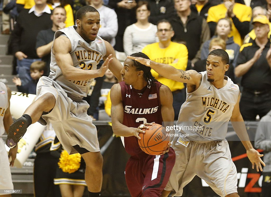Wichita State's Tekele Cotton (32) and Demitric Williams (5) pressure Southern Illinois' Desmar Jackson in the second half at Koch Arena in Wichita, Kansas, on Wednesday, January 9, 2013. The host Shockers won, 82-76.
