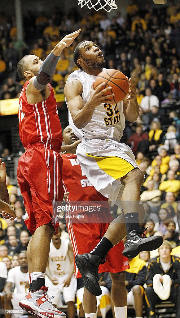 Wichita State's Tekele Cotton (32) goes up for two against Illinois State's Jackie Carmichael in the second half at Koch Arena in Wichita, Kansas, on Wednesday, January 16, 2013. Wichita State won, 74-62.