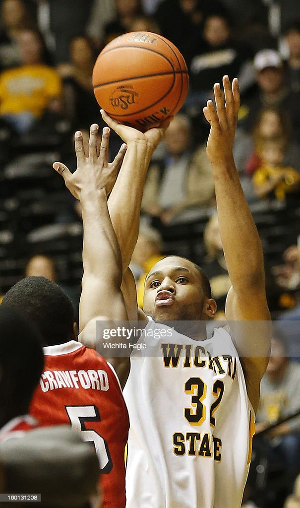 Wichita State's Tekele Cotton shoots a three-pointer against Bradley's Jalen Crawford in the second half at Koch Arena in Wichita, Kansas, Saturday, January 26, 2013. WSU defeated Bradley, 73-39.