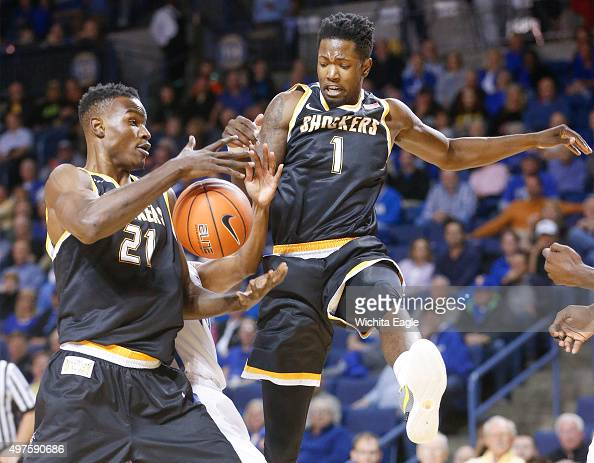 Wichita State's Tom Wamukota and Zach Brown battle for a rebound against Tulsa during the first half at the Reynolds Center in Tulsa Okla on Tuesday...