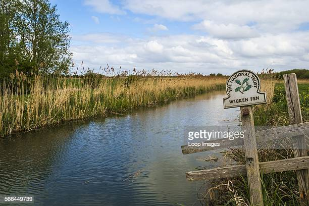 Wicken Fen Nature Reserve sign next to a river