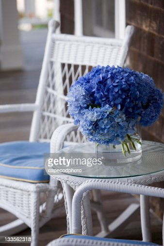 Wicker and blue Hydrangea  on a porch