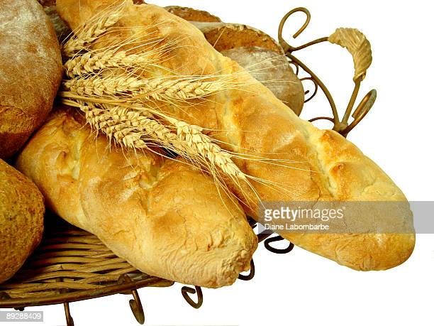 Wicker and Wire Basket of Homemade Bread with Clipping Path