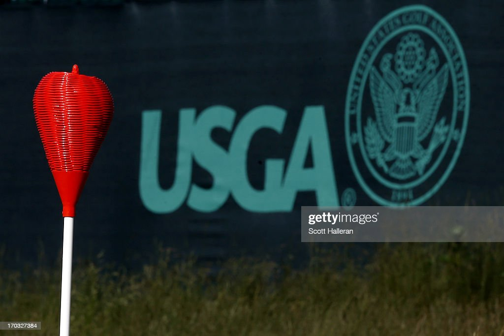 A wicker basket flag stick is seen alongside a USGA logo during a practice round prior to the start of the 113th US Open at Merion Golf Club on June...
