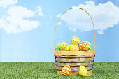 closeup of wicker basket full of colorful easter eggs