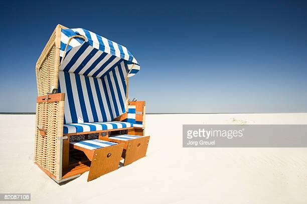 Wicker beach chair on beach