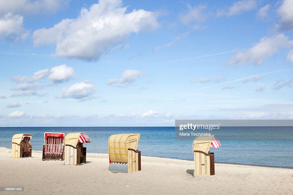 Wicker beach chairs at the sunny beach
