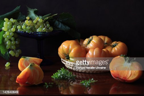 Wicker bowl of yellow tomatoes