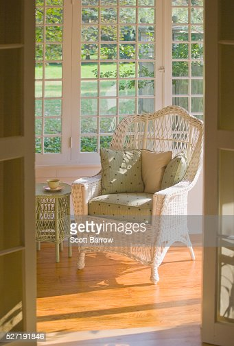 Wicker chair in sunny room : Stock Photo