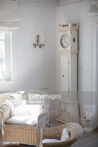 Wicker chairs and clock in living room