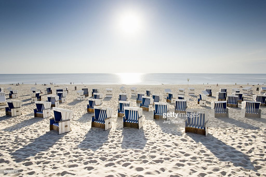 Wicker chairs on beach