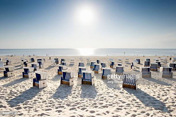 Wicker chairs on beach