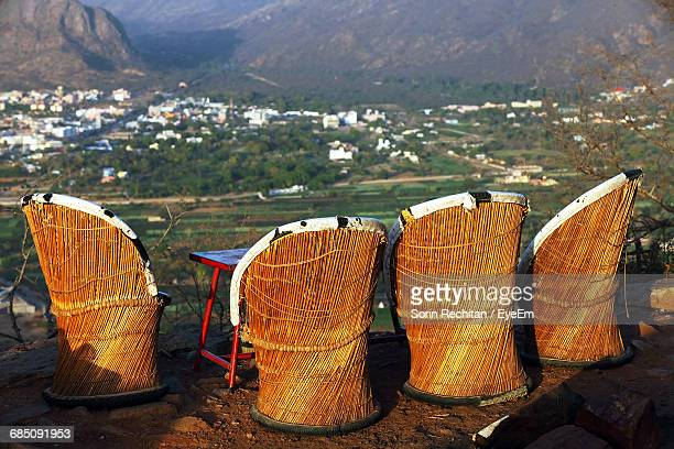 Wicker Chairs On Hill Overlooking Landscape