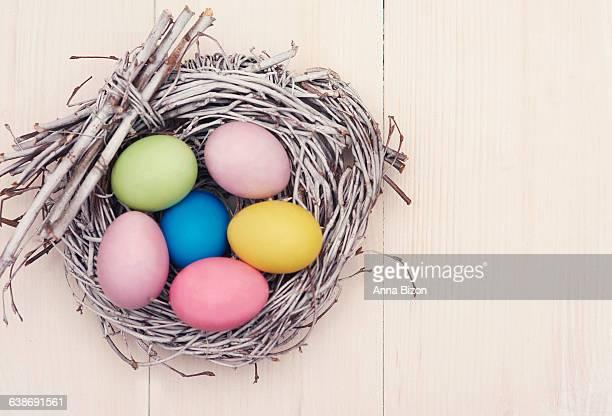 Wicker nest full of multi colored eggs. Debica, Poland