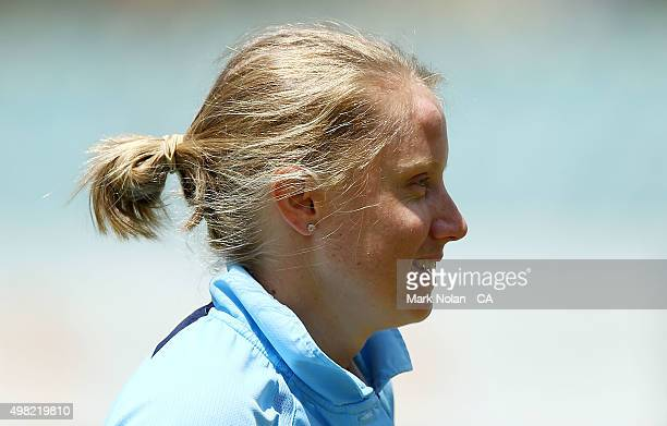 Wicket keeper Alyssa Healy of the Breakers leaves the field after being hit in the head with the ball during the WNCL match between the Victoria...