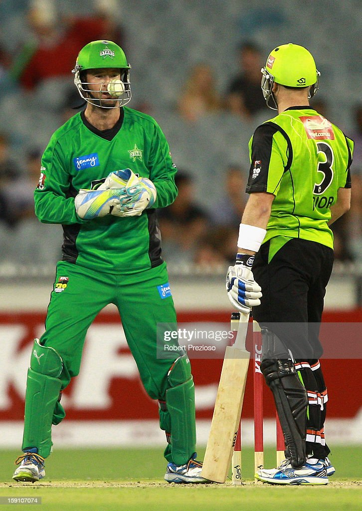 Wicket Keeper Rob Quiney of the Stars is struck by the ball during the Big Bash League match between the Melbourne Stars and the Sydney Thunder at Melbourne Cricket Ground on January 8, 2013 in Melbourne, Australia.
