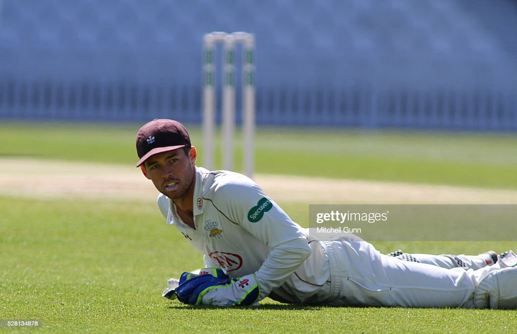 wicketkeeper <a gi-track='captionPersonalityLinkClicked' href=/galleries/search?phrase=Ben+Foakes&family=editorial&specificpeople=7622687 ng-click='$event.stopPropagation()'>Ben Foakes</a> of Surrey reacts after conceding four byes during the Specsavers County Championship Division One match between Surrey and Durham at the Kia Oval Cricket Ground, on May 04, 2016 in London, England.