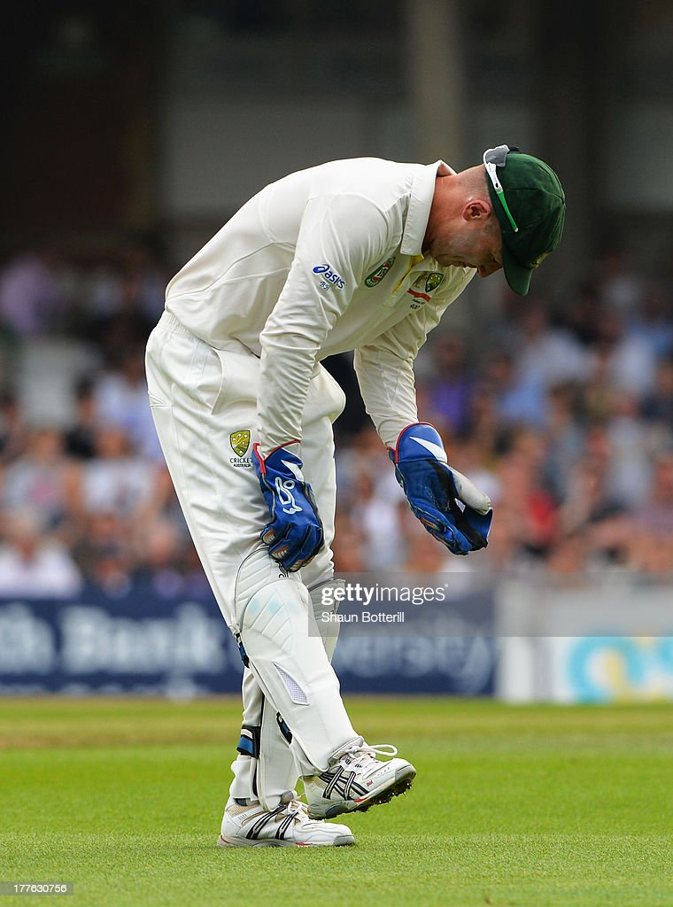 Wicketkeeper Brad Haddin of Australia adjusts his pads after being hit stopping a delivery during day five of the 5th Investec Ashes Test match between England and Australia at the Kia Oval on August 25, 2013 in London, England.