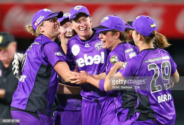 Wicketkeeper Emily Smith Heather Knight and Veronica Pyke of the Hurricanes celebrates after running out Jenny Taffs of the Renegades during the...