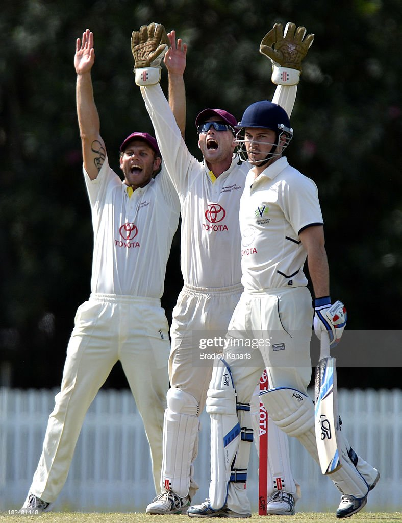 Wicketkeeper James Pierson of Queensland successfully appeals for the wicket of Dylan Kight of Victoria during day one of the Futures League match between Queensland and Victoria at Allan Border Field on September 30, 2013 in Brisbane, Australia.